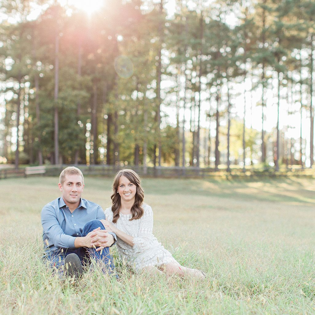 engaged couple in field, pine trees, open field - Finnigan's Run Farm