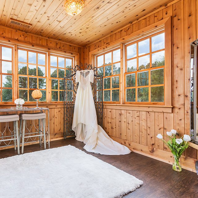 wedding dress hanging out screen in wooden room - Finnigan's Run Farm